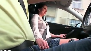 Handjob in the car from a big tits cutie